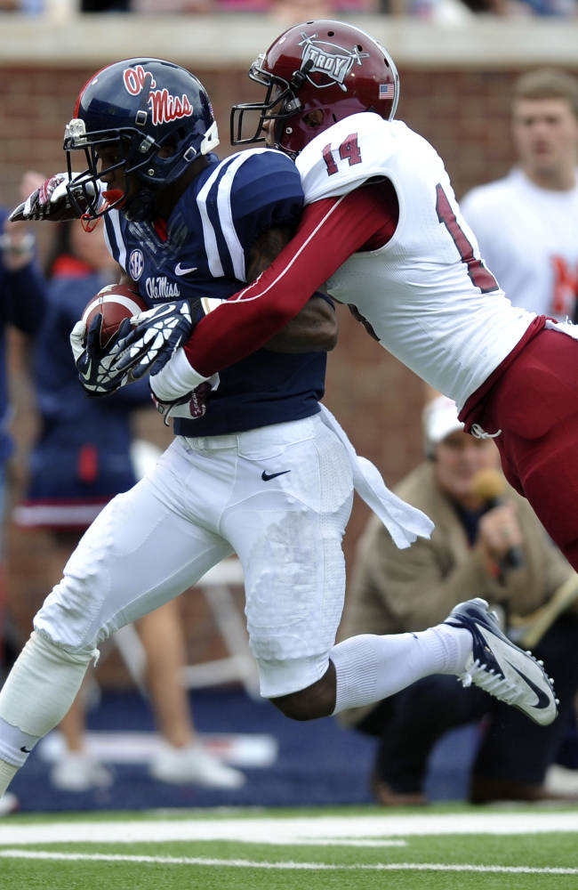 Mississippi running back I'Tavius Mathers (5) scores on a pass play as Troy safety Rishad Goode (14) defends  during an NCAA college football game in Oxford, Miss., Saturday, Nov. 16, 2013