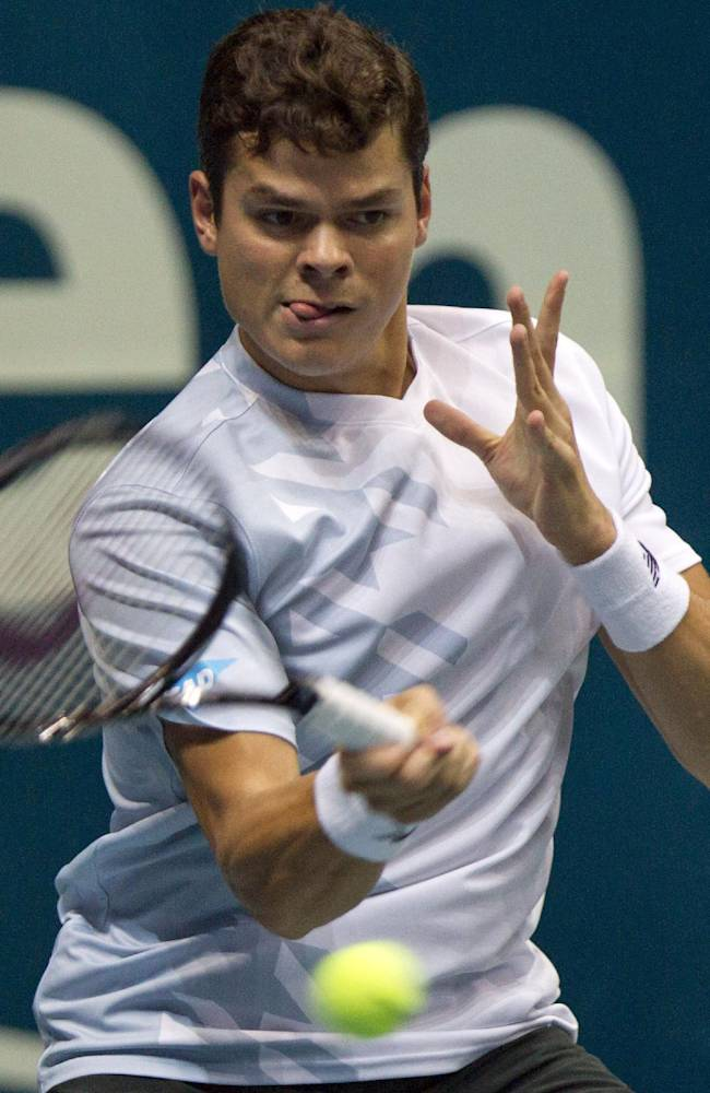 Milos Raonic of Canada returns a shot against Tomas Berdych of the Czech Republic during their final match of the Thailand Open tennis tournament in Bangkok, Thailand Sunday, Sept. 29, 2013. Raonic won the match 7-6, 6-3