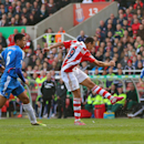 Stoke City's Peter Odemwingie, centre, scores during the English Premier League soccer match against Hull City, at the Britannia Stadium, Stoke On Trent, England, Saturday March 29, 2014