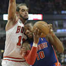 Detroit Pistons forward Greg Monroe, right, drives to the basket against Chicago Bulls center Joakim Noah during the first half of an NBA basketball game in Chicago on Friday, April 11, 2014 The Associated Press
