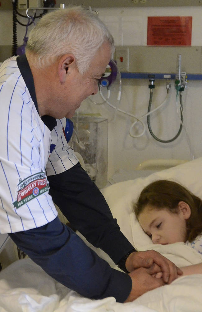 Chicago Cubs manager Rick Renteria visits with Addison Kurtz of Glenview, Ill., as the Cubs new skipper visited with children at Advocate Children's Hospital in Park Ridge, Ill.,  Friday, Jan. 17, 2014