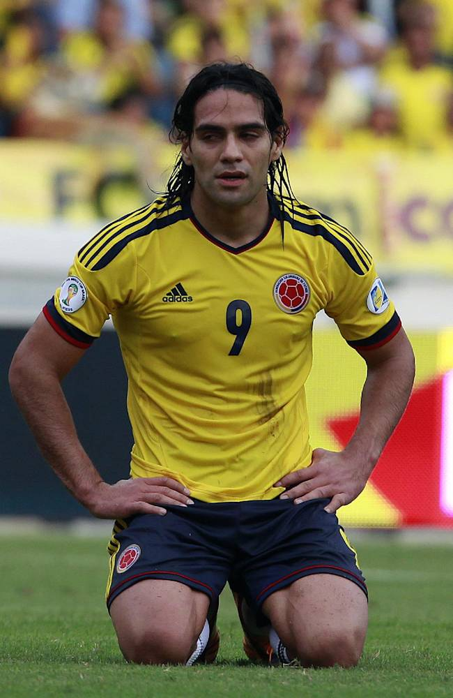 Colombia's Radamel Falcao Garcia reacts after missing a chance to score against Chile during a 2014 World Cup qualifying soccer match in Barranquilla, Colombia, Friday, Oct. 11, 2013