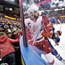 Detroit Red Wings Henrik Zetterberg (40) is checked by Edmonton Oilers Benoit Pouliot (67) during first period NHL hockey action in Edmonton, Alberta, on Tuesday Jan. 6, 2015 The Associated Press