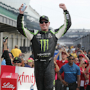 Kyle Busch celebrates winning the NASCAR Xfinity Series auto race at Indianapolis Motor Speedway in Indianapolis, Saturday, July 25, 2015. (AP Photo/AJ Mast)