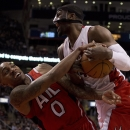 Toronto Raptors forward Patrick Patterson, right, rebounds against Atlanta Hawks guard Jeff Teague (0) during fourth-quarter NBA basketball game action in Toronto, Wednesday, Feb. 12, 2014 The Associated Press