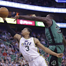 Utah Jazz's Trey Burke (3) goes to the basket as Boston Celtics' Brandon Bass, right, defends in the second half of an NBA basketball game, Monday, Feb. 24, 2014, in Salt Lake City. The Jazz won 110-98 The Associated Press