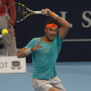 Spain's Rafael Nadal returns a ball to Croatia's Borna Coric during their quarterfinal match at the Swiss Indoor tennis tournament at the St. Jakobshalle in Basel, Switzerland, Friday Oct. 24, 2014. (AP Photo/Keystone, Georgios Kefalas)