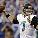 Jacksonville Jaguars' Chad Henne (7) throws during the first half of an NFL football game against the Indianapolis Colts, Sunday, Dec. 29, 2013, in Indianapolis. (AP Photo/Michael Conroy)
