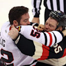 Chicago Blackhawks' Brandon Bollig (52) fights Ottawa Senators' Chris Neil (25) during first-period NHL hockey game action in Ottawa, Ontario, Friday, March 28, 2014 The Associated Press