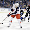 Columbus Blue Jackets center Boone Jenner (38) fires the puck past Tampa Bay Lightning goalie Ben Bishop for a goal during the first period of an NHL hockey game Saturday, Dec. 6, 2014, in Tampa, Fla The Associated Press