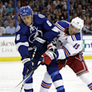 New York Rangers center Brad Richards (19) ties up Tampa Bay Lightning defenseman Sami Salo (6), of Finland, during the first period of an NHL hockey game Monday, Nov. 25, 2013, in Tampa, Fla The Associated Press
