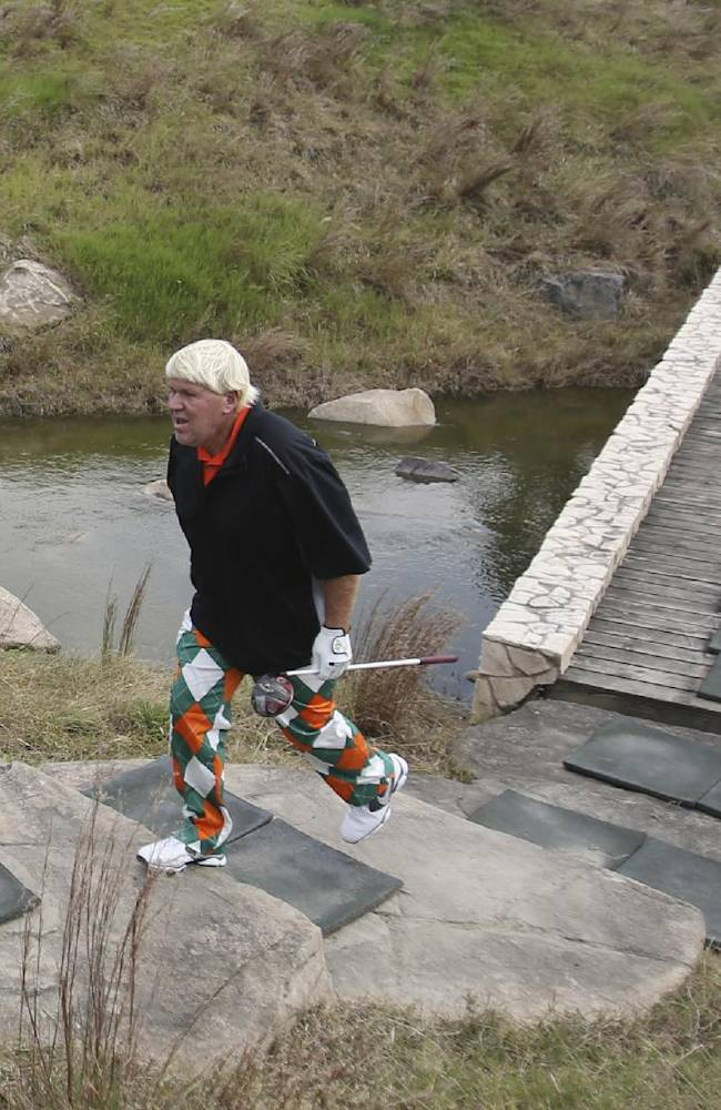 John Daly of the U.S. walks toward to the 3rd fairway during a pro-am competition ahead of the BMW Masters golf tournament at the Lake Malaren Golf Club in Shanghai, China, Wednesday, Oct. 23, 2013. The European Tour event will begin on Oct. 24