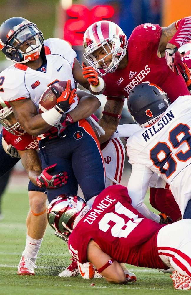 Illinois' V'Angelo Bentley (2) is brought down by the Indiana defense during the first half of an NCAA college football game, Saturday, Nov. 9, 2013, in Bloomington, Ind