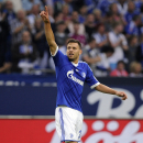 Schalke's Adam Szalai of Hungary celebrates after scoring during the German first division Bundesliga soccer match between FC Schalke 04 and Hamburger SV in Gelsenkirchen, Germany, Sunday, Aug. 11, 2013. (AP Photo/dpa, Marius Becker)