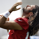 Tennessee Titans quarterback Charlie Whitehurst throws back his hair as he stretches during NFL football training camp Sunday, July 27, 2014, in Nashville, Tenn The Associated Press