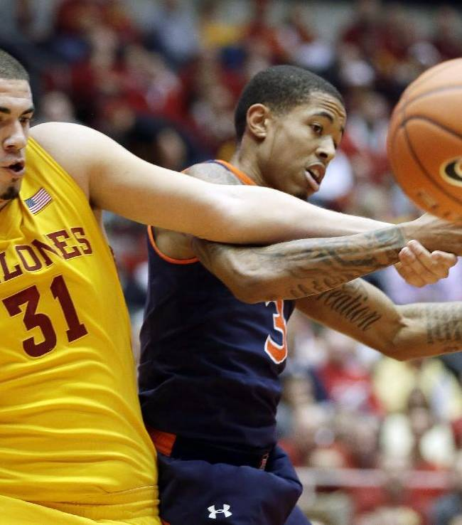 Iowa State forward Georges Niang, left, and Auburn guard Chris Denson fight for a rebound during the first half of an NCAA college basketball game Monday, Dec. 2, 2013, in Ames, Iowa