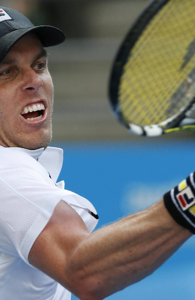 Sam Querrey of the U.S. makes a forehand return to Ernests Gulbis of Latvia  during their second round match at the Australian Open tennis championship in Melbourne, Australia, Wednesday, Jan. 15, 2014
