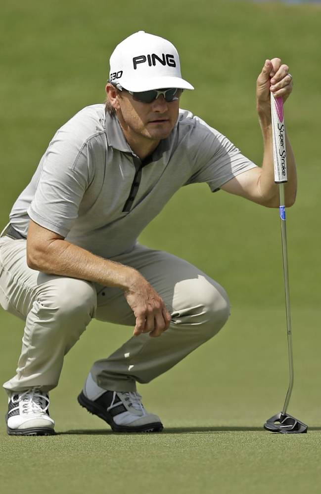 Heath Slocum lines up a putt on the 17th hole during the second round of the Wyndham Championship golf tournament in Greensboro, N.C., Friday, Aug. 15, 2014