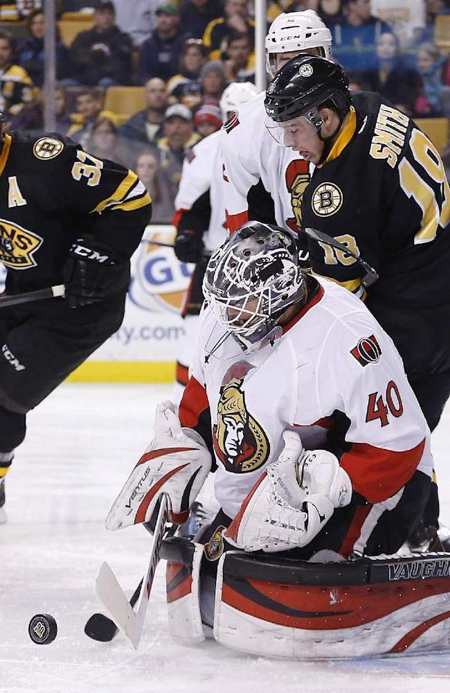 Boston Bruins' Reilly Smith (18) cannot get the puck past Ottawa Senators' Robin Lehner (40) in the second period of an NHL hockey game in Boston, Friday, Dec. 27, 2013