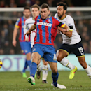 Crystal Palace's James McArthur, left, competes for the ball with Tottenham Hotspur's Mousa Dembele during the English Premier League soccer match between Crystal Palace and Tottenham Hotspur at Selhurst Park, London, England, Saturday, Jan. 10, 2015