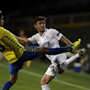 Dynamo Moscow's Yuri Zhirkov, right, vies for the ball with Estoril's Anderson Luiz during the Europa League group E soccer match between Dynamo Moscow and Estoril at the Antonio Coimbra Da Mota stadium, in Estoril, Portugal, Thursday, Oct. 23, 2014. Zhir