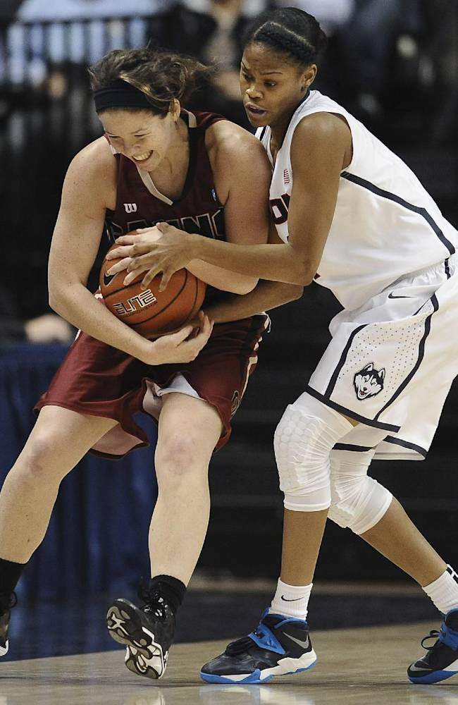 Connecticut's Moriah Jefferson, right, pressures Gannon's Kelley Sundberg during the first half of an NCAA college exhibition basketball game, Friday, Nov. 1, 2013, in Storrs, Conn
