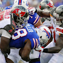 Tampa Bay Buccaneers defensive tackle Clinton McDonald (98) and Larry English (51) tackle Buffalo Bills running back C.J. Spiller (28) during the first half of a preseason NFL football game Saturday, Aug. 23, 2014, in Orchard Park, N.Y The Associated Pres