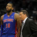 Detroit Pistons head coach John Loyer speaks with forward Greg Monroe (10) in an NBA basketball game against the Atlanta Hawks in Atlanta, Tuesday, April 8, 2014 The Associated Press