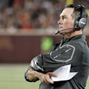 In this Aug. 16, 2014, file photo, Minnesota Vikings head coach Mike Zimmer looks on during the second half of an NFL preseason football game against the Arizona Cardinals in Minneapolis. After enduring the fallout from child abuse allegations against sta
