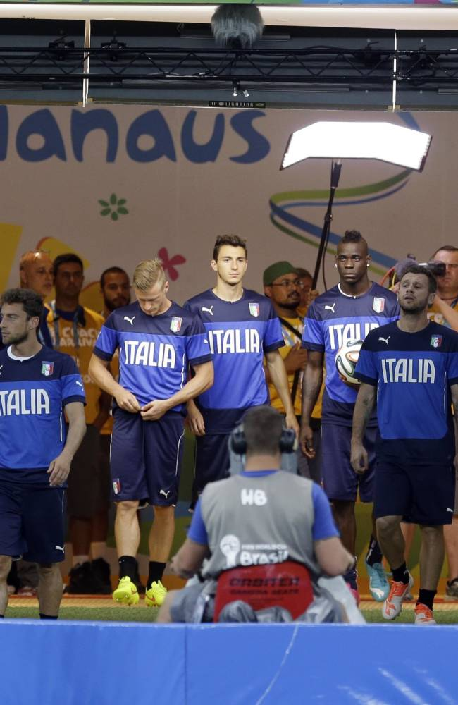 Italy players enter the pitch during a training session at Arena da Amazonia in Manaus, Brazil, Friday, June 13, 2014.  Italy plays in group D of the 2014 soccer World Cup