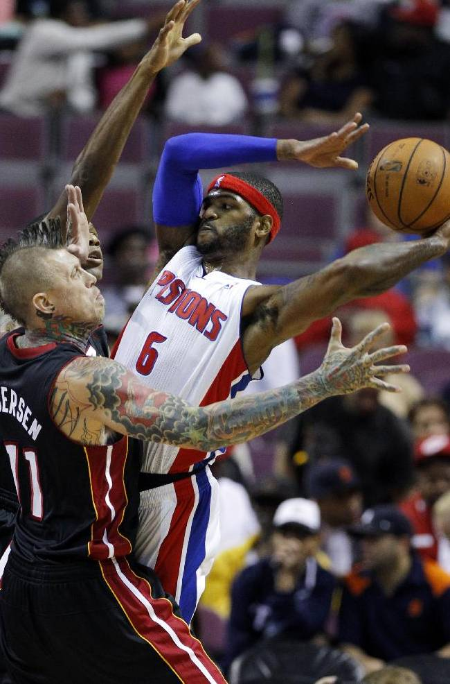 Detroit Pistons forward Josh Smith (6) tries to pass the ball against Miami Heat forward Chris Anderson (11) and James Jones, rear, in the first half of an NBA basketball preseason game on Thursday, Oct. 10, 2013, in Detroit