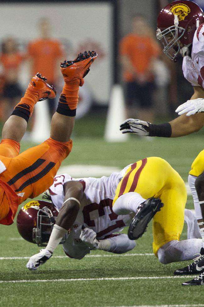 Oregon State running back Terron Ward (28) dives for yardage against Southern California in an NCAA college football game in Corvallis, Ore., Friday, Nov. 1, 2013