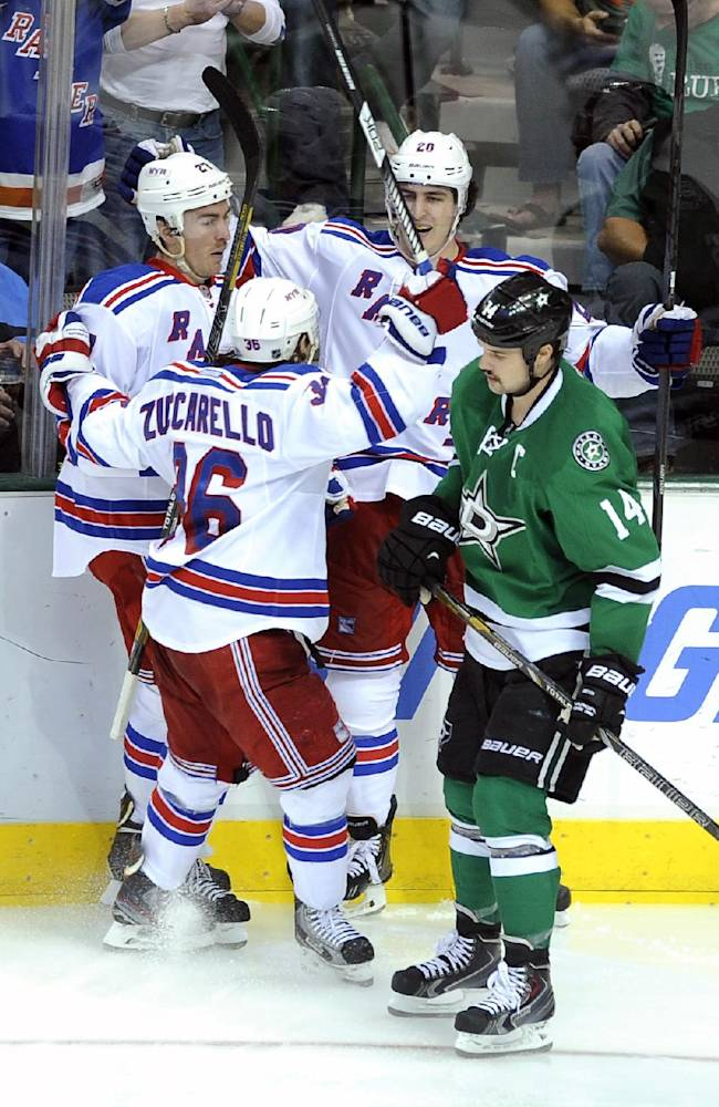 New York Rangers right wing Mats Zuccarello (36), defenseman Ryan McDonagh (27) and left wing Chris Kreider (20) celebrate after Kreider's goal as Dallas Stars left wing Jamie Benn (14) skates by during the third period of an NHL hockey game, Thursday Nov. 21, 2013 in Dallas