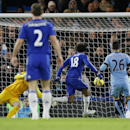 Chelsea's Loic Remy ,center, scores the first goal of the game during the English Premier League soccer match between Chelsea and Manchester City at Stamford Bridge stadium in London, Saturday, Jan. 31, 2015
