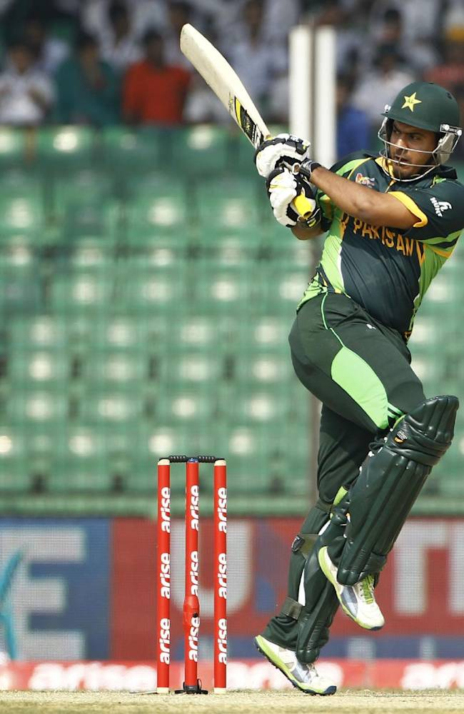 Pakistan's Sharjeel Khan plays a shot during their match against Afghanistan in the Asia Cup one-day international cricket tournament in Fatullah, near Dhaka, Bangladesh, Thursday, Feb. 27, 2014