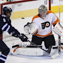 Philadelphia Flyers goaltender Steve Mason (35) is beaten by a slapshot from the point by Winnipeg Jets' Dustin Byfuglien (not shown) during third-period NHL hockey game action in Winnipeg, Manitoba, Friday, Nov. 15, 2013. Jets' Evander Kane (9) looks for