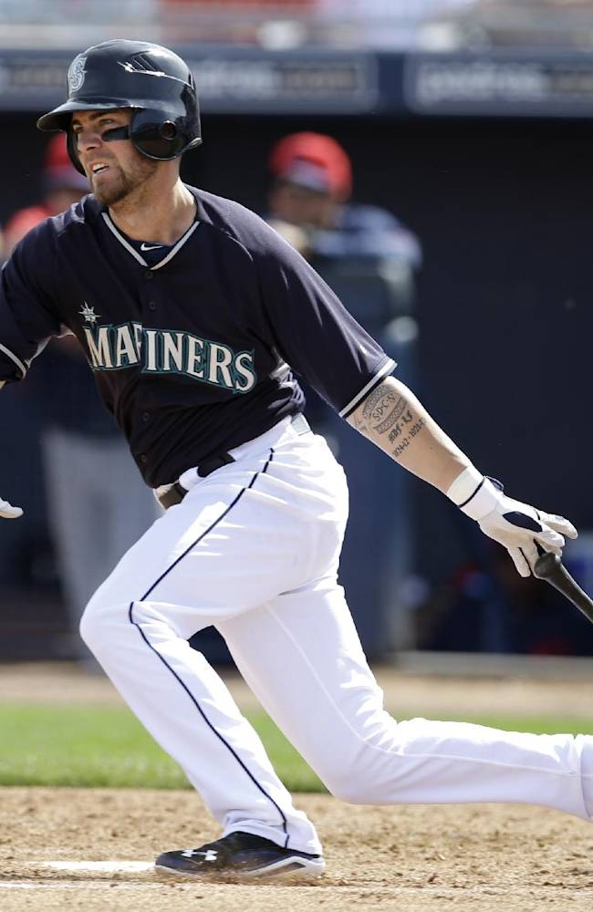 Seattle Mariners' Nick Franklin follows through on a two-run single off Cleveland Indians relief pitcher Nick Hagadone in the first inning of a spring training baseball game, Wednesday, March 5, 2014, in Peoria, Ariz. The hit scored Robinson Cano and Justin Smoak in the 8-5 Indians win