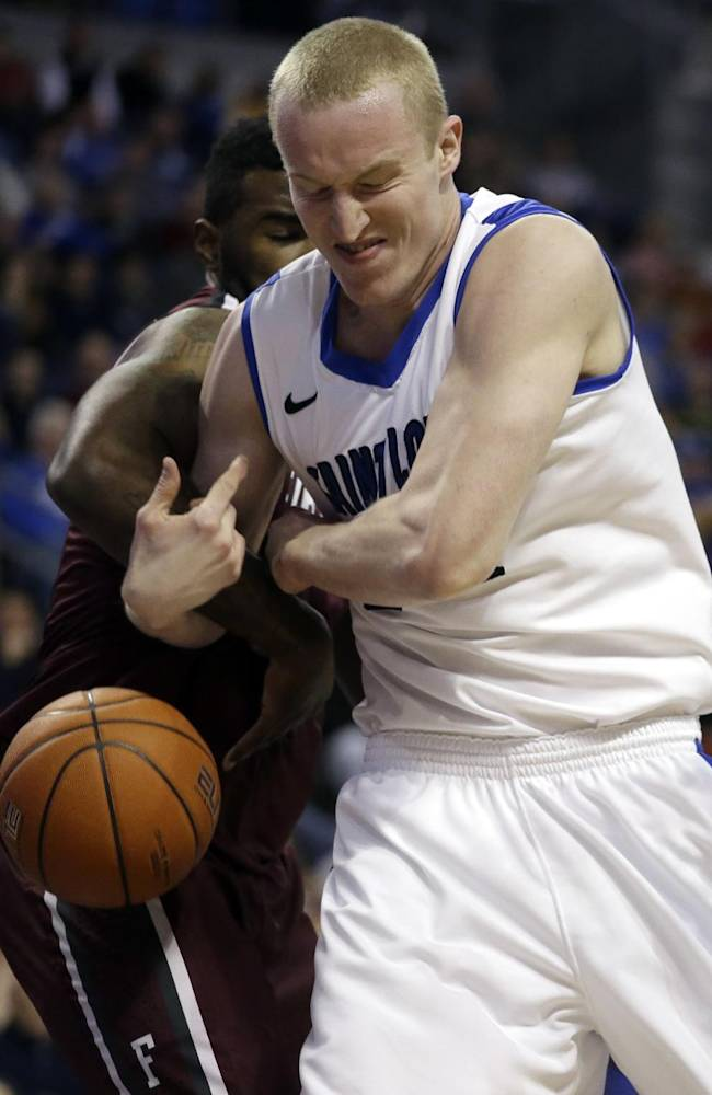Saint Louis' John Manning, right, loses control of the ball as he gets tangled up with Fordham's Travion Leonard, left, during the second half of an NCAA college basketball game Saturday, Jan. 18, 2014, in St. Louis. Saint Louis won 70-48
