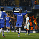 Chelsea's Demba Ba, centre, celebrates the opening goal with Chelsea's Oscar during the Champions League Group E soccer match between Chelsea and Steaua Bucharest at Stamford Bridge Stadium in London Wednesday, Dec. 11, 2013