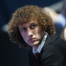 Chelsea s Brazilian soccer player David Luiz watches the ATP World Tour Finals double semifinal tennis match between Bruno Soares of Brazil, Alexander Peya of Austria and Bob Bryan, Mike Bryan of United States at the O2 Arena in London Sunday, Nov. 10, 20