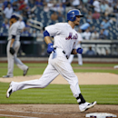 New York Mets' Lucas Duda, right, runs on his second-inning home run off San Diego Padres starting pitcher Tyson Ross, left,in a baseball game in New York, Wednesday, July 29, 2015. (AP Photo/Kathy Willens)