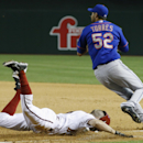 New York Mets pitcher Carlos Torres (52) looks over at second base after beating Arizona Diamondbacks' Tony Campana, left, to first base for an out during the seventh inning of a baseball game on Monday, April 14, 2014, in Phoenix. The Mets defeated the