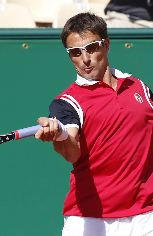 Tommy Robredo of Spain, returns the ball to Milos Raonic of Canada during their third round match of the Monte Carlo Tennis Masters tournament in Monaco, Thursday, April 17, 2014. Raonic won 6-4 6-3