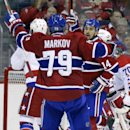 Montreal Canadiens' Tomas Plekanec (14), of the Czech Republic, celebrates with teammate Andrei Markov (79), of Russia, after scoring a goal during the third period of an NHL hockey game against the Washington Capitals, Thursday, Oct 9, 2014, in Washingto