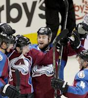 Colorado Avalanche's Matt Duchene, second from left, celebrates after scoring the game winning goal past Winnipeg Jets goalie Al Montoya (35) during overtime of an NHL hockey game on Monday, March 10, 2014 in Denver. The Avalanche won 3-2. (AP Photo/Barry Gutierrez)