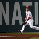 Washington Nationals left fielder Bryce Harper runs to field a ball hit by St. Louis Cardinals' Jhonny Peralta during the fourth inning of a baseball game at Nationals Park Thursday, April 17, 2014, in Washington The Associated Press