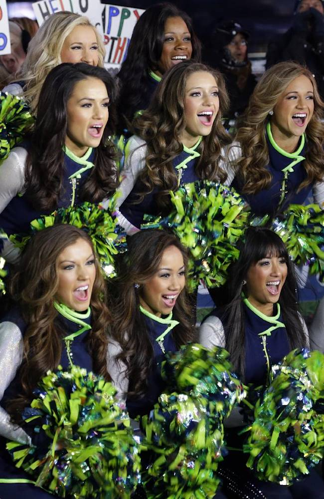 Seattle Seahawks Sea Gals cheerleaders cheer Friday, Jan. 31, 2014 during a live broadcast of Good Morning America at Times Square in New York. The Seattle Seahawks will play the Broncos Sunday in the NFL Super Bowl XLVIII football game in East Rutherford, N.J