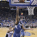 Minnesota Timberwolves' Corey Brewer (13) shoots a basket as he gets in front of Orlando Magic's Arron Afflalo (4) during the second half of an NBA basketball game in Orlando, Fla., Saturday, April 5, 2014. Orlando won 100-92 The Associated Press