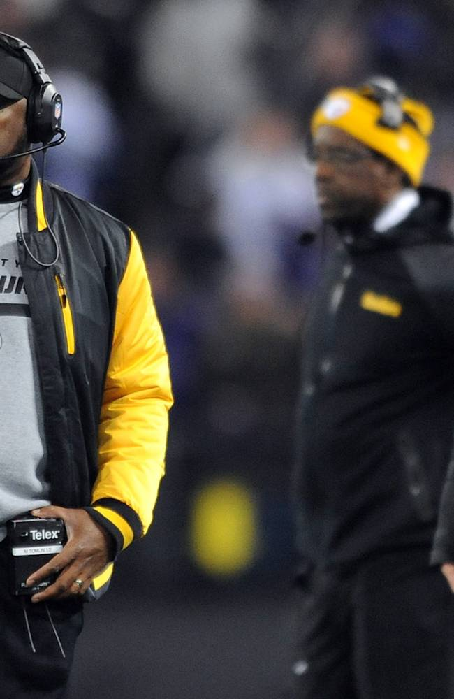 Pittsburgh Steelers head coach Mike Tomlin, left, watches from the sideline in the second half of an NFL football game against the Baltimore Ravens, Thursday, Nov. 28, 2013, in Baltimore