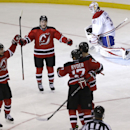 New Jersey Devils Andrei Loktionov (21), Reid Boucher (15) and Mark Fayne (7) celebrate a goal by Michael Ryder (17) during the third period of an NHL hockey game against the Montreal Canadiens, Wednesday, Dec. 4, 2013, in Newark, N.J., as Canadiens goali